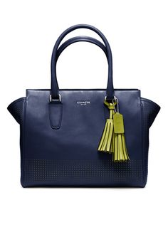 Navy and green is the perfect classy combo for this Coach Legacy bag
