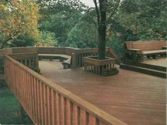 double decks for homes | This deck features a tree surround to accommodate a growing trunk yet ...