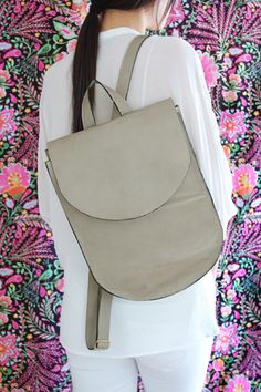 Beautiful and luxurious neutral leather backpack from the new 2016 collection was crafted from high quality soft Italian leather in a beautiful neutral sand color that will add elegance to your everyday look. Whether you are wearing all denim or a white t-shirt with your favorite pair of pants. You will look chic and classy.  Size: Width: 27 cm ( 10.5) Height - 33 cm ( 13 ) Depth - 9 cm ( 3.5 ) Double & stitched adjustable straps. One top handle Inside zipper pocket for small essentials…