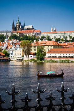 boat on the river Vltava with Prague Castle in the background, Czech Republic | Darby Sawchuk