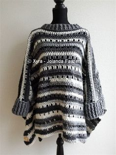 ****CROCHET-PATTERN **** (English-US & Dutch) This poncho is extra wide. Because of the bands, the poncho will no not cover the hands. It is crocheted with Rachel 100 grams / 250 meters​ and Royal 100 grams / 241 meters, with hook number 10. It is approx. 67cm (height) * 127cm (width), excl. collars measured. Necessities: Rachel* – approx. 665 grams = approx. 1662,5 meters - 1818,78 yards Royal* – approx. 85 grams = approx. 204,85 meters - 224,11 yards *Rachel...