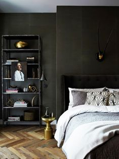 Styled bookshelves in a dramatic bedroom