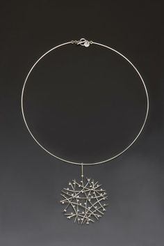 Touch of the Sun necklace by DALLAE KANG-USA, 2012. Sterling silver.