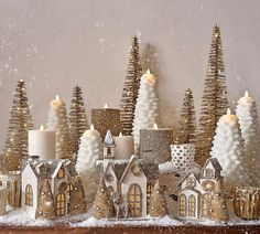 Create a festive table with Christmas table decorations from Pottery Barn and entertain with style. Find Christmas centerpieces, candles, lights and more. Christmas Village Houses, Christmas Village Display, Christmas Villages, Rose Gold Christmas Decorations, Christmas Centerpieces, Xmas Decorations, Elegant Christmas Decor, Holiday Decor, Noel Christmas