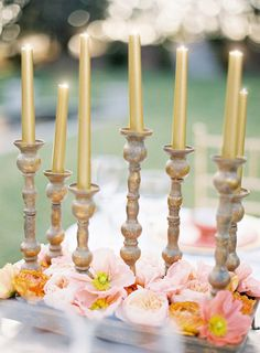 Gold Tapered Candles | See More Ideas: http://thebridaldetective.com/the-ultimate-guide-to-metallics/