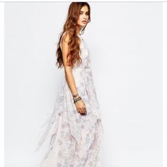 Ivory Tower Maxi Dress With Halter Neck In Lace Tiers of pretty ruffles sweeten this silk-like gown. Banded neckline. Halter straps. Concealed zipper. Hits at the ankles. Polyester. Dry clean. Imported. Color: Cloud Combo Free People Dresses Maxi