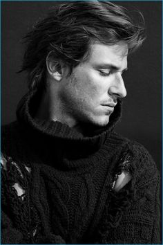 Posing for a portrait, Gaspard Ulliel wears a distressed sweater from Faith Connexion for L'Express Styles.