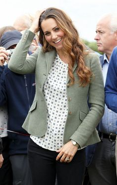 Catherine, Duchess of Cambridge, aka Kate Middleton, at the start of the Ring of Fire ultra-marathon in Anglesey. She is wearing a jacket from Ralph Lauren, blouse by Zara, and her Pied à Terre Imperias wedges. 08-30-13