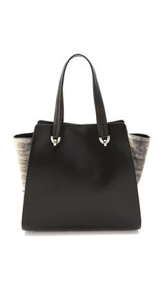 A roomy ZAC Zac Posen tote has exotic flair with snake-embossed gussets. A logo stamp details the smooth leather exterior, and double rolled handles carry over the magnetic top line. The lined interior features a shorter set of handles and 3 pockets. Dust bag included. @Shopbop