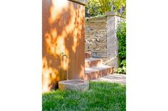 Add a water feature with a self-circulating filtration system. It will conserve water while providing pets with a clean, fresh drink. [dog-friendly yard]