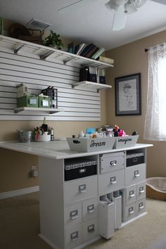 Desk Area. Love how neat and clean this area looks. So organized. I have trouble finding storage that my large 3 ring binders will fit into.