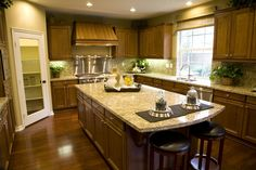 I like the colors in this kitchen. I would prefer a solid wood pantry door with a pop of color...