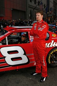 Dale Earnhardt Jr. Photos - Dale Earnhardt Jr., driver of the #8 Budweiser Chevrolet, stands next to his car, prior to a Victory Lap, in Times Square on November 29, 2006 in New York City - NASCAR NEXTEL Cup Series Champions Week