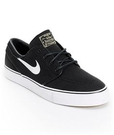 Low profile canvas Nike SB Zoom Stefan Janoski pro model skate shoes feature a durable black canvas upper, double stitched perforated padded toe cap, vulcanized white rubber outsole with black foxing for better board feel and flexibility on or off your bo