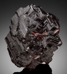 SPESSARTINE Navegadora Claim, Penha do Norte, Conselheiro Pena, Doce Valley, Minas Gerais, Brazil  Deep red-brown coloration with gemmy luster and complex crystal faces. Weighs 892.5 carats,