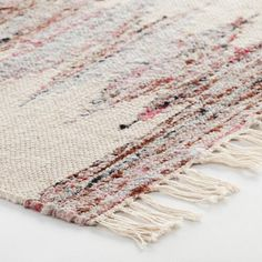 Handwoven of soft cotton and silky yarn for a soft underfoot feel with a low profile, our exclusive rug features a romantic pink pattern that enlivens any room.
