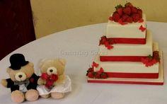 White chocolate and strawberry wedding cake. White chocolate icing, buttercream and vanilla cake