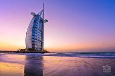 Waves sweep the shoreline near the Burj Al-Arab in Dubai.