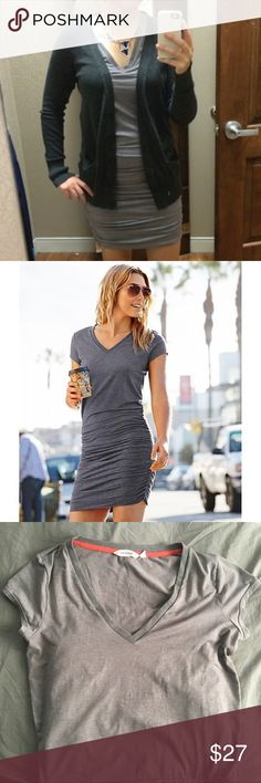"Athleta V-neck tee shirt dress Light gray heather, super soft, relaxed on top and more fitted on bottom. In great condition, no stains/tears/signs of wear. I'm 5'8"" and it hits a few inches above my knee. Athleta Dresses"