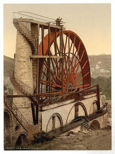 Laxey Wheel, Isle of Man. A large waterwheel built in 1854 to pump water from the mine shafts. Located in the Irish Sea between the islands of Great Britain and Ireland within the British Isles. Old Buildings, Abandoned Buildings, Abandoned Places, Magic Places, Places To Go, Isle Of Man Tt, Water Mill, Irish Sea, Isle Of Wight
