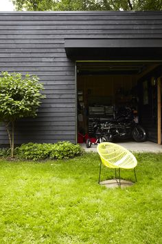 siding stained black and a lemon green chair -- (stain siding as well?