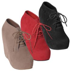 A lace-up front adds style to these wedge shoes by Hailey Jeans Co. The 'Honey-2' faux suede booties are completed with a round toe and hidden platform for extra height.