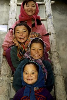 4 children sitting on the rungs of a wooden ladder, smiling, laughing. Bonnie Koenig                                                                   • 10 weeks ago                                                                                                   Beautiful children