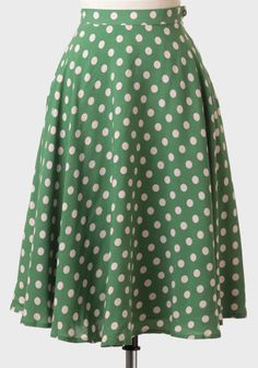 green polka dot midi skirt. perfect for the holidays and i love the retro vibe.