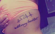 With every heart beat writing tattoo on side body
