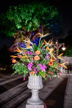 Ceremony floral for a wedding at Animal Kingdom's Tree of Life including roses, orchids and bird of paradise