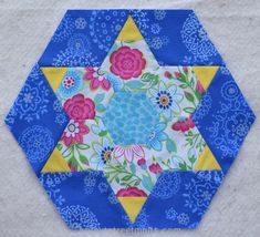 Smitten Large #1 hexagon blocks My classes for the Smitten quilt finished in September and I have all of the large and small blocks completed.  When the blocks went up on the design wall, I noticed that only three of the blocks contain a solid yellow fabric. I would love to use the first block with the … … Continue reading →