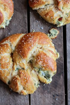 Spinach and Artichoke Stuffed Beer Soft Pretzels with Mozzarella and Parmesan.