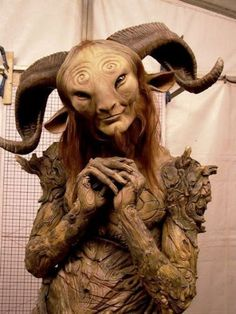 "Doug Jones in the Faun costume during the filming of ""Pan's Labyrinth"" (Spanish: El laberinto del fauno) written and directed by Guillermo del Toro "" Pans Labyrinth Faun, Labyrinth Movie, Cosplay, I Love Cinema, Movie Makeup, Makeup Art, Sfx Makeup, Sculptures, Lion Sculpture"