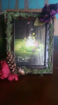 Card table Frames I made using moss, pine cones, acorn n silk flowers