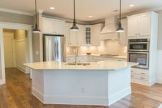 Bill Clark Homes - New Home Builder and Real Estate Developer Taupe Kitchen, Kitchen Redo, Kitchen Remodel, Kitchen Floor Plans, Kitchen Island With Seating, Kitchen Island Shapes, Corner Kitchen Layout, Kitchen Family Rooms, New Home Builders