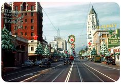 Christmas on Hollywood Boulevard in Los Angeles c. 1952. Note the Red Car trolley in the background.