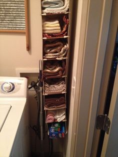 Small apartment idea:  Canvas shoe storage unit for kitchen items that would typically go in a drawer.