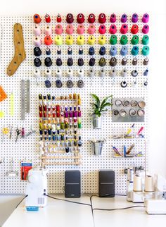 Using a giant pegboard to organize your sewing studio // Closet Case Patterns https://closetcasepatterns.com/achieving-max-org-how-we-stay-organized-in-our-sewing-studio/