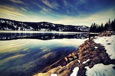 Payette Lake - McCall, Idaho. I held my baby in my arms and stood on this frozen lake just to say i'd done it. i couldn't take more than one step~ i've seen horror movies after all... i know what happends when you walk on an iced over lake!