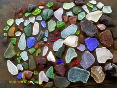 """Lake Erie Seaglass Treasures ~ submitted by Jaron , Hamburg, NY USA. Mom says, """"The photo was taken at home after going through my son's beautiful seaglass collection.   He is 8 years old and makes regular trips with me to the lake to collect seaglass...""""     Read more: http://www.odysseyseaglass.com/eagle-eye-seaglass-treasures-june-2012-sea-glass-photo-contest.html"""