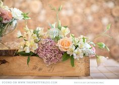 Table flowers in wooden box | Photo: Catherine Mac Photography