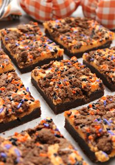 Halloween Cream Cheese Brownies. If you're headed to a spooky party and need a quick and incredible festive treat to share, these Halloween Cream Cheese Brownies are just the thing! They'll be devoured before you can snap your finger! #halloweenbrownies #halloweendesserts #dessertrecipes #halloweentreats #halloweenrecipes #dessertrecipes