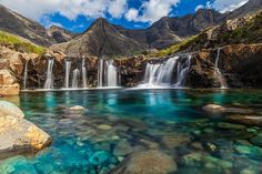 Fairy Pools, Isle of Skye, Scotland. Etched into the jagged landscape of the Isle of Skye are the Fairy Pools, named so because the sparkling water seems so magical. Vacation Destinations, Dream Vacations, Vacation Spots, Scotland Destinations, Summer Vacations, Vacation Travel, Travel List, Travel Goals, Holiday Destinations