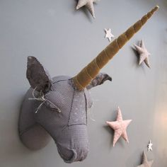 unicorn - maybe in wood and use as a hanger or draw motif of unicorn on the wall and just have the spike sticking out.