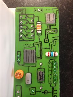 Computer circuit board / motherboard made in sugarpaste with edible pen to decorate the cake board for a computer cake.