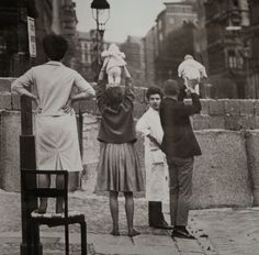 Residents of West Berlin showing their children to their grandparents who reside on the Eastern side, May 9th, 1961.