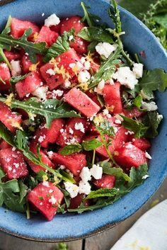 Watermelon Salad with Arugula, Feta, & Fresh Herbs with Watermelon, Olive Oil, Lemon, Lemon Juice, Fresh Mint, Feta Cheese, Arugula, Freshly Ground Black Pepper, Kosher Salt.