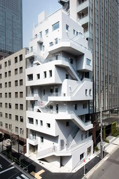 NIKKEN SEKKEI wraps ARAKAWA office building in emergency staircases Architecture Design Concept, Office Building Architecture, Arch Architecture, Building Facade, Facade Design, Exterior Design, Chinese Architecture, Futuristic Architecture, Architecture Sketchbook