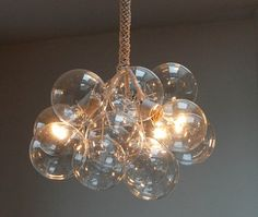 Jean Pelle's DIY bubble chandelier project for ReadyMade--The chandelier is made from 12 hand-blown glass balls and three clear globe bulbs held together by cables wrapped in cotton twine Bubble Chandelier, Chandelier Lighting, Glass Chandelier, Crystal Chandeliers, Eclectic Chandeliers, Unique Chandelier, Industrial Chandelier, Stair Lighting, Pendant Lamps
