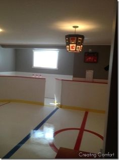 basement hockey room...oh the boys would love this!